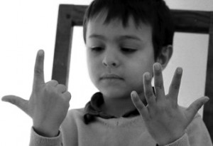 10 Dec 2011, Montrouge, France --- 6-year-old boy counting with his fingers --- Image by © Philippe Lissac/Corbis